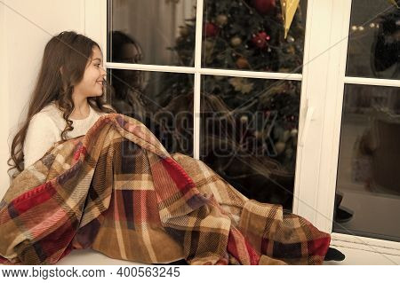 Comfortable And Warm. Little Child Feel Comfortable At Xmas Home. Small Girl Relax On Window Sill. C