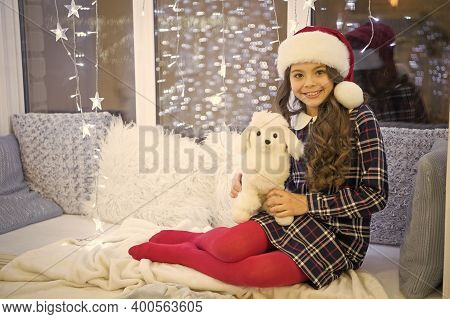 Amazing Gift From Santa. Happy Child Got Gift For Christmas. Little Girl Play With Toy Gift. Christm