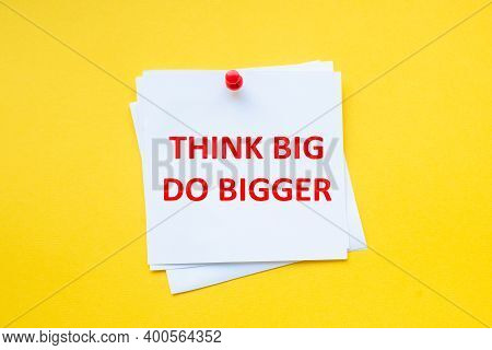 Think Big Do Bigger. Motivational Slogan On White Sticker With Yellow Background