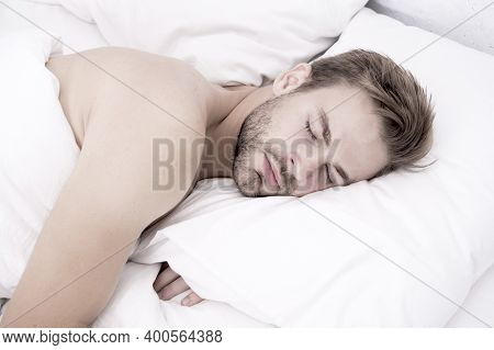 Man Handsome Unshaven Guy In Bed. Tips Sleep Better. Bearded Man Relaxing On Pillow. Soft Pillow. En