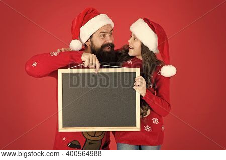 New Year And Christmas Party Advertising. Happy Family Hold Advertising Board. Bearded Man And Littl