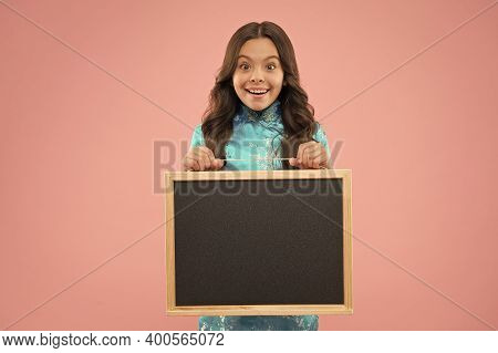 Advertising Your School Event. Happy Child Hold Advertising Board. Little Girl Advertising Product O