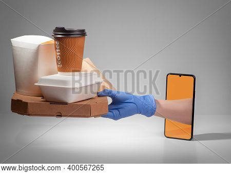 Hand In A Latex Glove Giving A Pile Of Boxed Food Through A Phone Screen