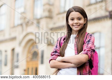 International Childrens Day. Confident Child Keep Arms Crossed In Schoolyard. School Education. Nove