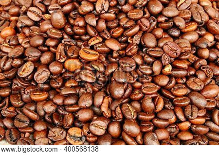 Roasted Arabica Coffee Beans Are Used In Large Quantities For The Background