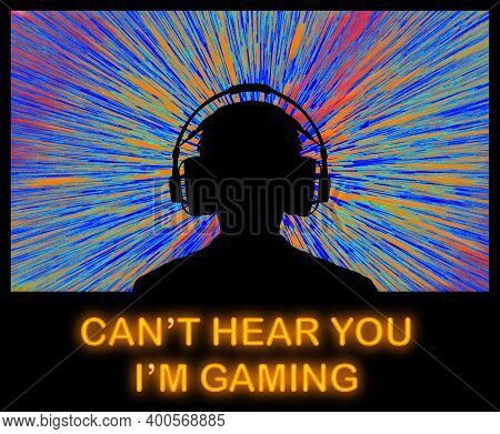 A Video Game Player In Headphones Sits In Front Of A Bright Video Screen. Neon Lights Spell The Word