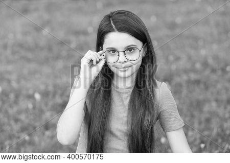 Choosing Trendy Accessories. Little Girl Wear Glasses Green Grass. Fashion Accessories. Designer Eye
