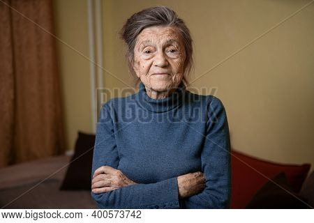 Elderly Caucasian Senior Grandmother Ninety Years Old Looks Attentively And Smiles, Feels Happy, Lar