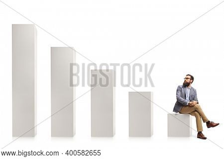 Bearded man sitting on a column and looking behind at rising column bars isolated on white background