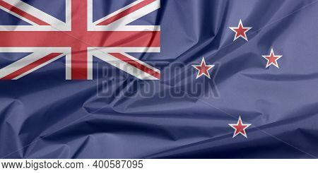 Fabric Flag Of New Zealand. Crease Of New Zealand Flag Background, A Blue Ensign With The Southern C