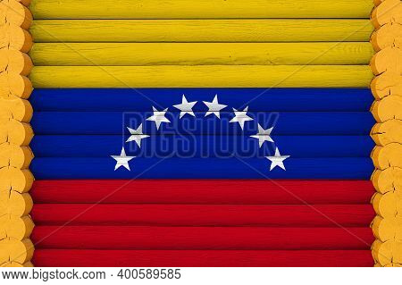National Flag  Of Venezuela On A Wooden Wall Background. The Concept Of National Pride And A Symbol