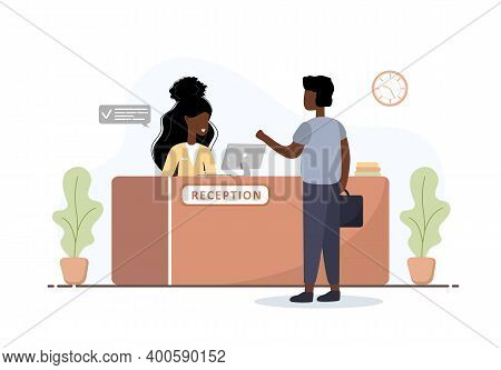 Reception Interior. African Woman Receptionist And Man With Briefcase At Reception Desk. Hotel Booki