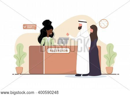 Reception Interior. African Woman Receptionist. Arab Couple At Reception Desk. Hotel Booking, Clinic