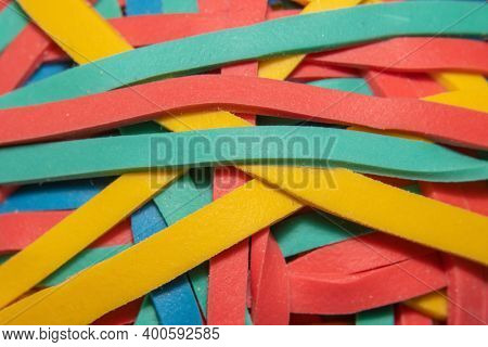 Close up shot of colorful rubber bands tangled together