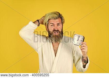 Noise Of Alarm Clock. Man Awake With Alarm Clock Ringing. Guy In Bathrobe. Circadian Rhythms Are Big