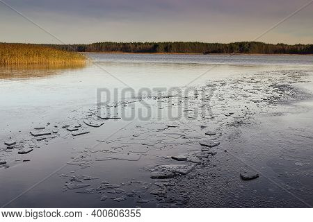 Broken Ice On A Frozen Lake In The Morning