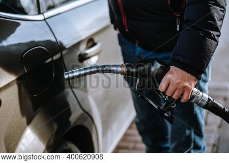 Man Preparing To Refuel A Car In The Gas Station, Refueling The Car