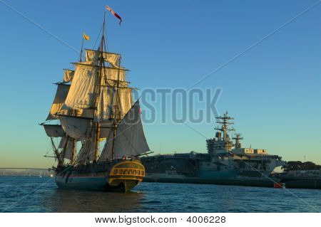 Hms Surprise Sailing Past The Uss Nimitz