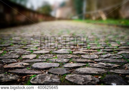 Old European Cobble Stone Road Perspective Blurred Background With Copy Space