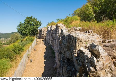 Grosseto, Italy - September 4th 2020. The Ruins Of The Etruscan Perimeter Walls In Roselle Or Rusell