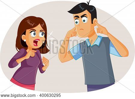 Wife Arguing With Husband While He Covers His Ears