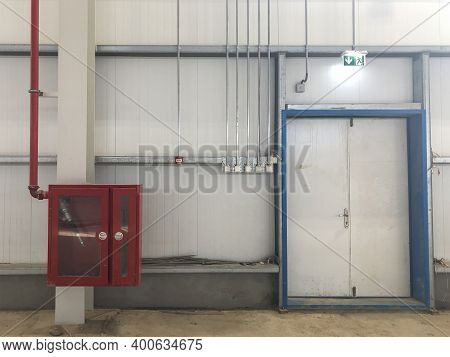 Fire Extinguisher Box With Fire Hose Inside And Emergency Exit