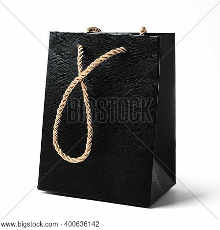 Black Gift Bag With Golden Strap Isolated