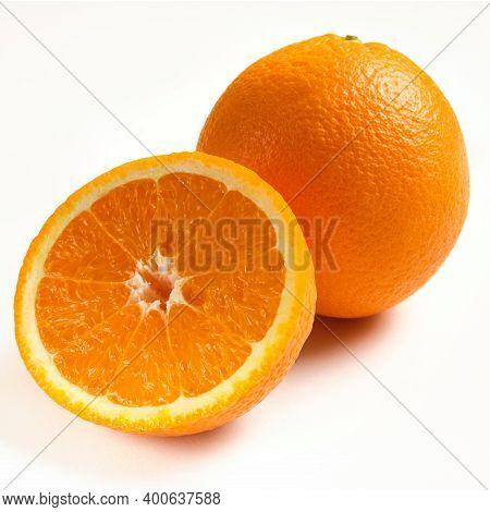 Whole And Sliced Ripe Oranges Isolated On White Background