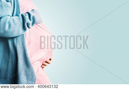 Pregnant Woman Holding Hands On Her Belly. Pregnancy, Gynecology Concept.
