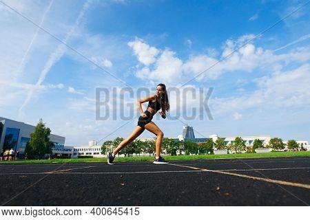 Athlete Runner Running On Athletic Track Training Her Cardio.