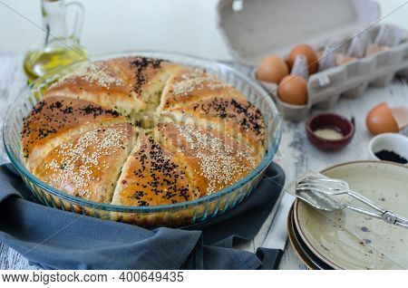 Traditional Leavened Bread With Black Seeds And  Sesame Seeds On A Glass Tray