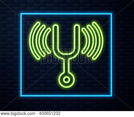 Glowing Neon Line Musical Tuning Fork For Tuning Musical Instruments Icon Isolated On Brick Wall Bac