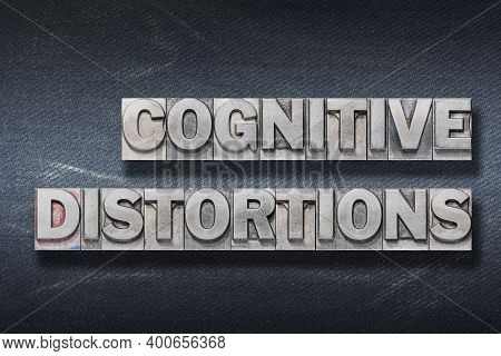 Cognitive Distortions Phrase Made From Metallic Letterpress On Dark Jeans Background