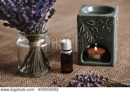 Aroma Lamp With An Aromatic Oil And Burning Candle With Bucket Of Lavender In The Glass, Aromatherap