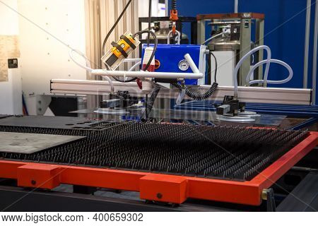 Mechanical Vacuum Metal Sheet Lifter Loading To Laser Cutting Machine In Production Line. Industrial