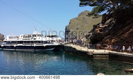Boat With Tourists In Sa Calobra, Mallorca Sa Calobra, Mallorca - June 21, 2018: Boat With Tourists