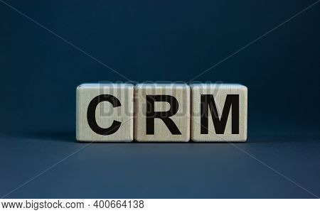 Crm Symbol. Concept Word 'crm - Customer Relationship Management' On Cubes On A Beautiful Grey Backg