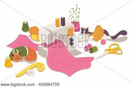 Concept Scene Of Seamstress Workplace With Cats In Clothes, Greenery And Sewing Accessories Items Is