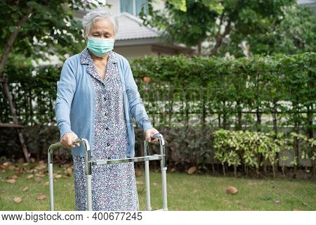 Asian Senior Or Elderly Old Lady Woman Wearing A Face Mask New Normal In Park For Protect Safety Inf