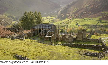 Old Decaying Farm Building Above A Valley In Yorkshire, Uk