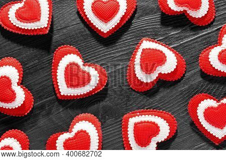 Pattern Of Red Hearts On Black Wooden Background