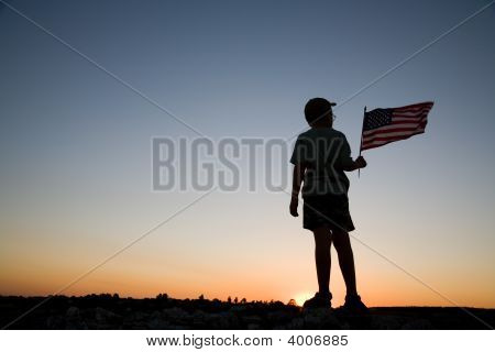 Young Boy At Sunset.