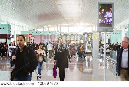Barcelona, Spain, April 2019: People Walking Along The International Departures Corridor Of El Prat