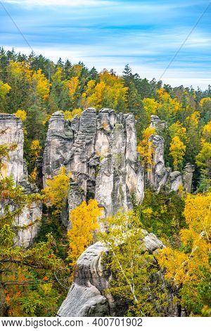 Prachov Rocks, Czech: Prachovske Skaly, Sandstone Rock Formation With Colorful Trees Of Autumn. Bohe