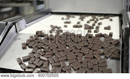 Production Line For The Production Of Chocolates. Candy Covered With Chocolate. Sweets Move Along Th