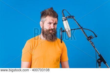 Karaoke. Man Singing With Microphone. Studio Records. Bearded Man Sing In Microphone. Microphone. Si