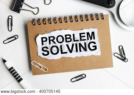 Problem Solving, Text On White Paper On A White Background Near A Magnifying Glass And Pencils