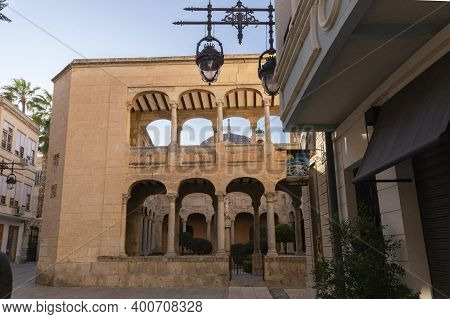 Orihuela, Spain - November 16, 2019: Street With Old Houses And Lanterns Overlooking The Cloisters O