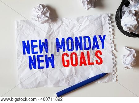 New Monday, New Goals Text Concept. Spiral Notebook Textbook, Wooden Pencil, New Monday, New Goals.