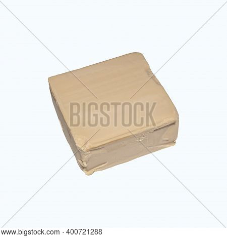 Yeast Pressed Isolated On A White Background.baking Yeast In A Briquette Photo On A White Background